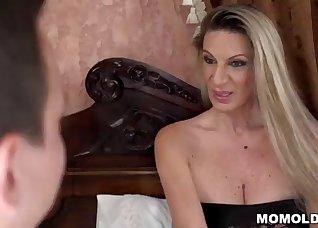 Sexy experienced MILF sucks a young cock