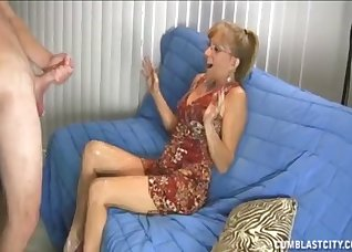 Sensual mom is jerking a big young cock