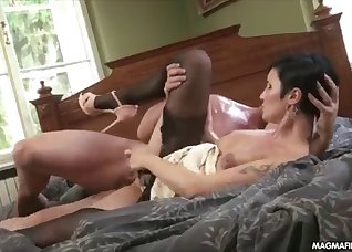 Short-haired lady takes a very fat cock