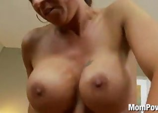 Big-boobed chick fucks with a huge dildo