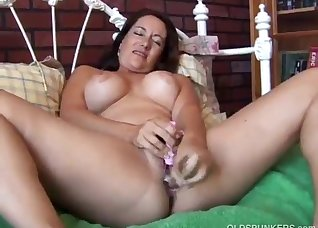 Busty brunette fucks with a sex tool