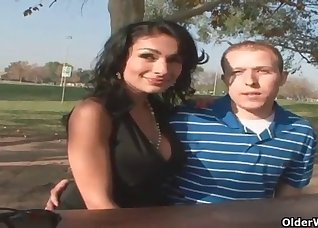 Busty brunette and a lucky young fucker