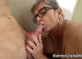 Short-haired mature gets a messy cumshot