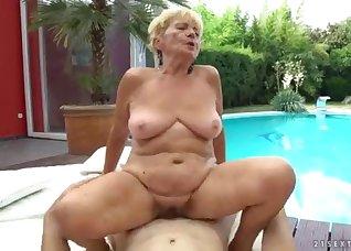Busty blonde is riding on a big boner